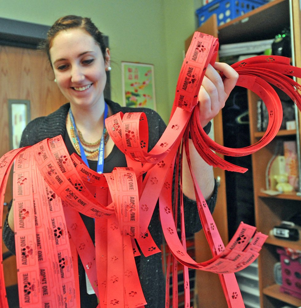 Parker Middle School teacher Nora Sweeney holds red tickets used in the school's new Positive Behavioral Interventions and Supports program in Taunton, Mass.