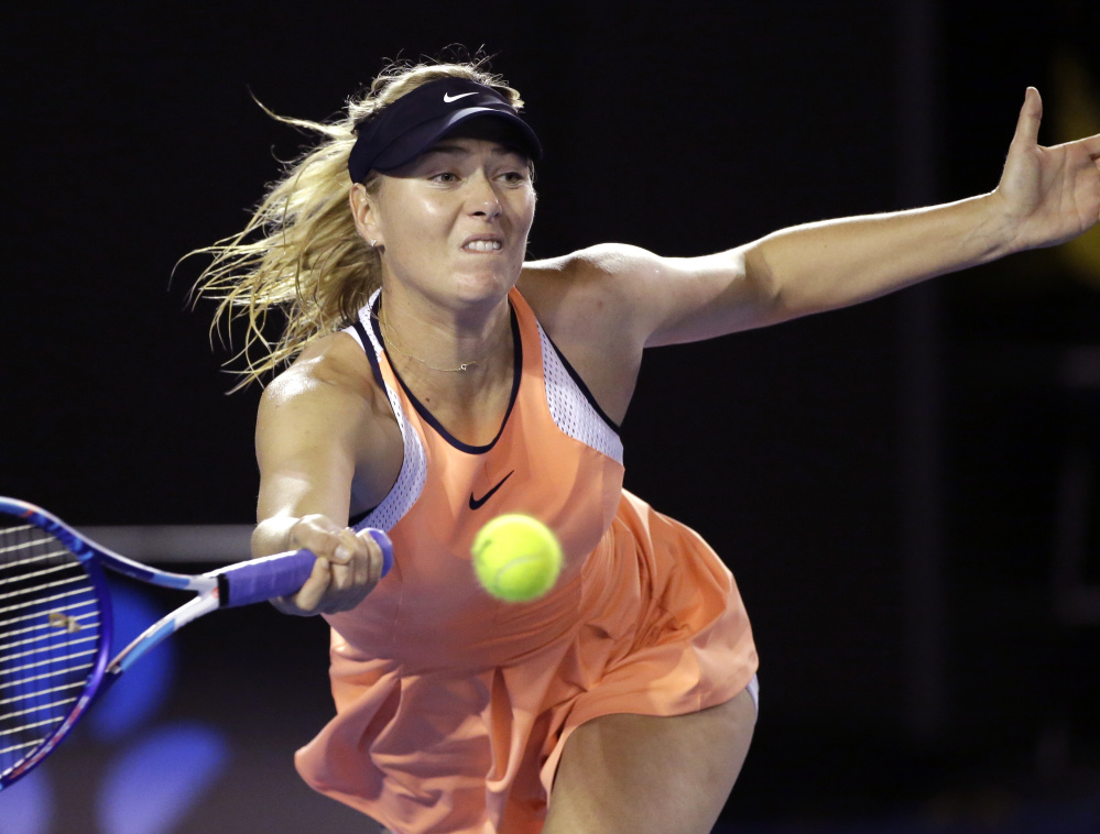 Maria Sharapova hits a forehand return to Belinda Bencic during their fourth-round match Sunday at the Australian Open. Sharapova won in straight sets, 7-5, 7-5.