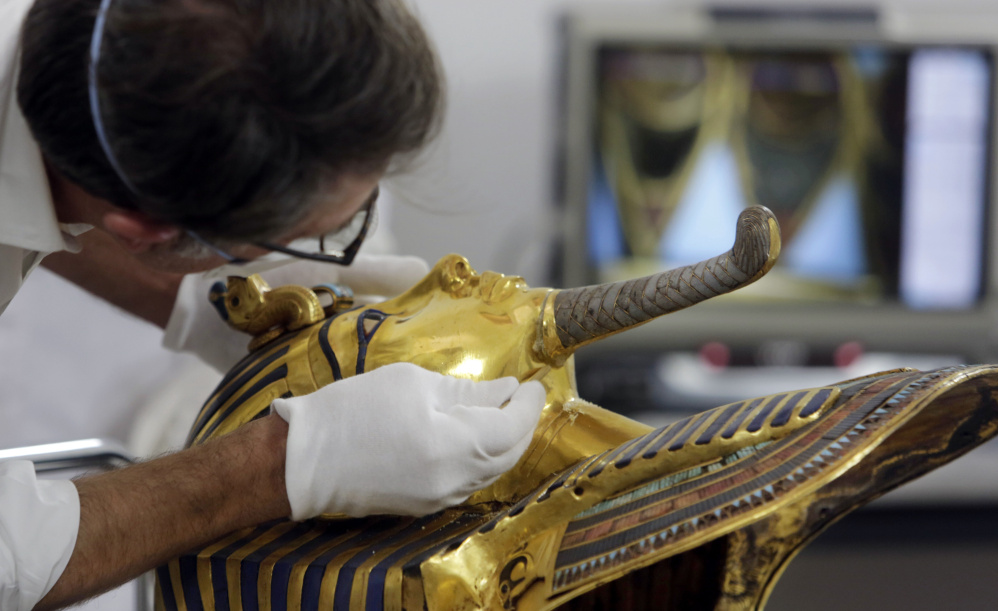 German restorer Christian Eckmann begins restoration work on the golden mask of King Tutankhamun in October, over a year after the beard was accidentally broken off and hastily glued back with epoxy, at the Egyptian Museum in Cairo.