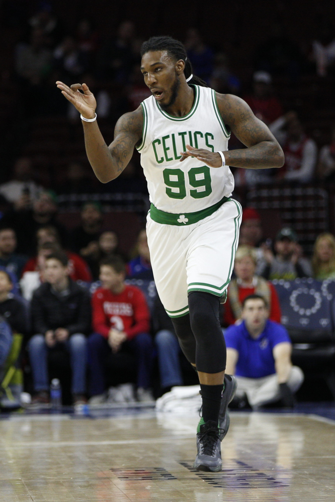 Boston's Jae Crowder celebrates after making a 3-pointer in the first half of the Celtics' 112-92 win over the 76ers on Sunday in Philadelphia.
