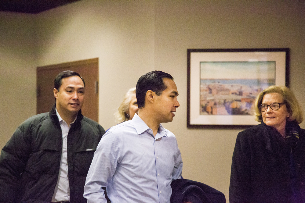 U.S. Secretary of Housing and Urban Development Julian Castro, center, walks with his brother Rep. Joaquin Castro, as they  attend a fundraising event for Hillary Clinton's presidential campaign at Preti Flaherty in Portland on Monday. Whitney Hayward/Staff Photographer