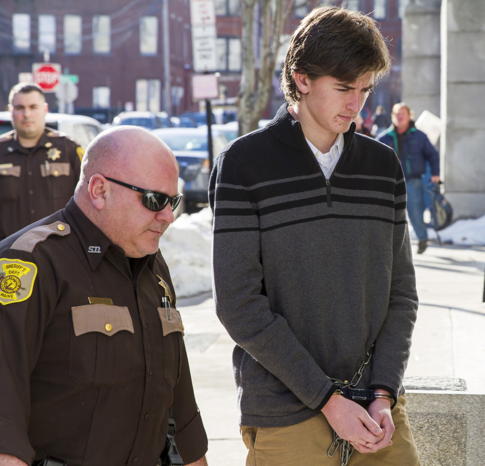 Mathew Gwyer is led into the Cumberland County Courthouse on Monday for a hearing in connection with the shooting of Scarborough man. Scarborough's police chief said residents are struggling to comprehend how such a crime could have happened, and that has led some to speculate and place blame.
