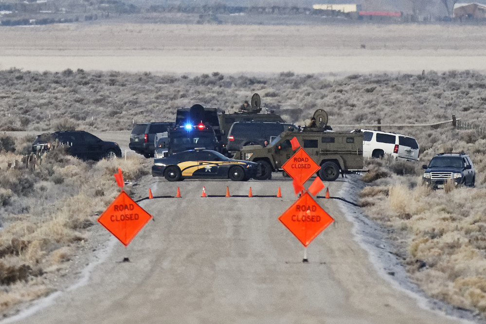 Law enforcement personnel block an access road to the Malheur National Wildlife Refuge on Wednesday near Burns, Ore. The refuge is occupied by an armed group.