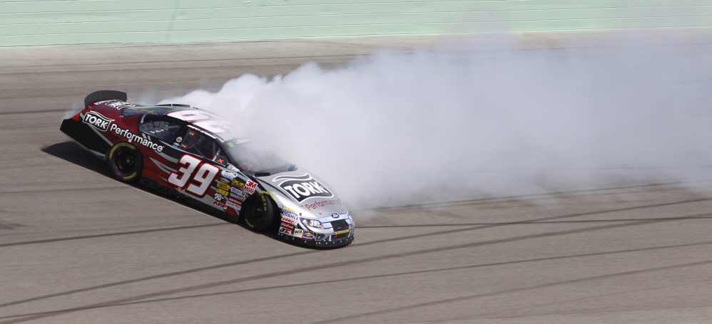 Sean Caisse spins out during a qualifying heat for the NASCAR Nationwide Ford 300 auto race in November 2010 in Homestead, Fla. Piece by piece, between 2010 and 2012, Caisse's personal and professional life disintegrated.