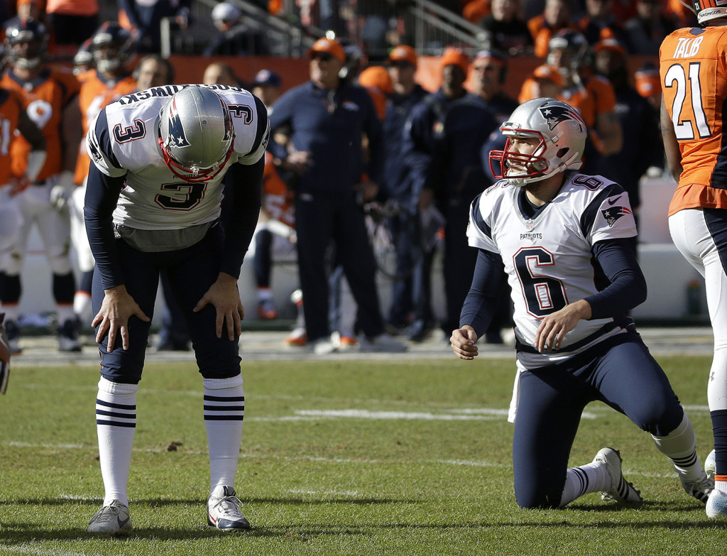New England Patriots punter Ryan Allen (6) looks on as Patriots kicker Stephen Gostkowski reacts after missing an extra point following a touchdown by Steven Jackson during the first half. The Associated Press