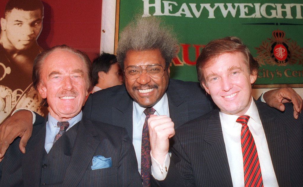 Donald Trump, right, pictured with his father, Fred Trump, far left, and boxing promoter Don King at a press conference in December 1987 in Atlantic City, N.J.  The Associated Press