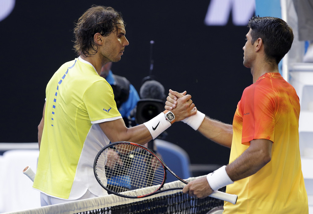 Rafael Nadal, left, of Spain congratulates compatriot Fernando Verdasco after their first round match at the Australian Open tennis championships in Melbourne, Australia, Tuesday. The Associated Press