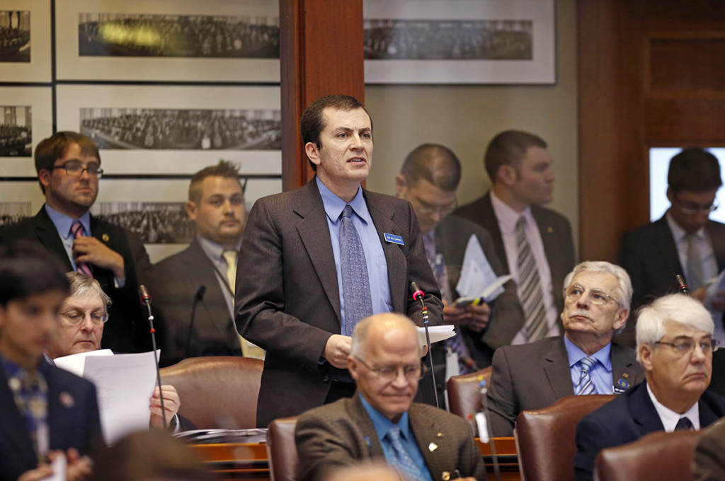 Democratic State Rep. Ben Chipman, D-Portland, submits an order to impeach Gov, Paul LePage, Thursday, at the State House in Augusta.