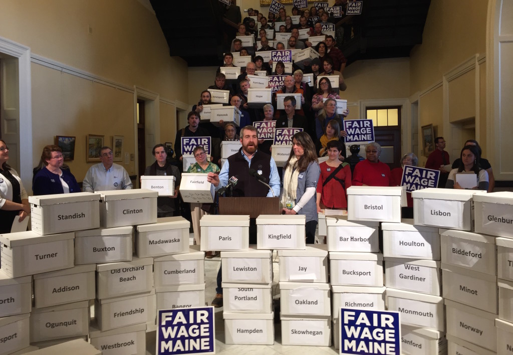 Advocates of a higher minimum wage hold a news conference in January announcing the filing of more than 75,000 petition signatures to put a proposal on the November ballot to raise Maine's minimum wage to $12 an hour by 2020. Kevin Miller/Staff Writer