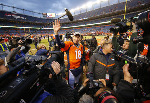 Denver Broncos quarterback Peyton Manning waves to the crowd after defeating the New England Patriots in the AFC Championship football game at Sports Authority Field. Kevin Jairaj/USA TODAY Sports