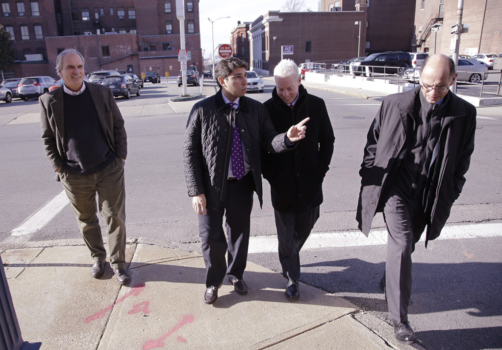 Fall River Mayor Jasiel Correia walks with a group of architechs in Fall River, Mass. The Associated Press