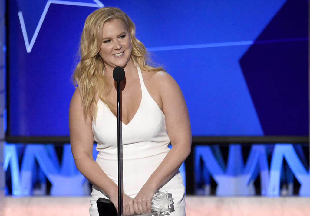 """Amy Schumer accepts the award for best actress in a comedy for """"Trainwreck"""" at the 21st annual Critics' Choice Awards on Sunday, Jan. 17, 2016, in Santa Monica, Calif. Photo by Chris Pizzello/Invision via AP"""