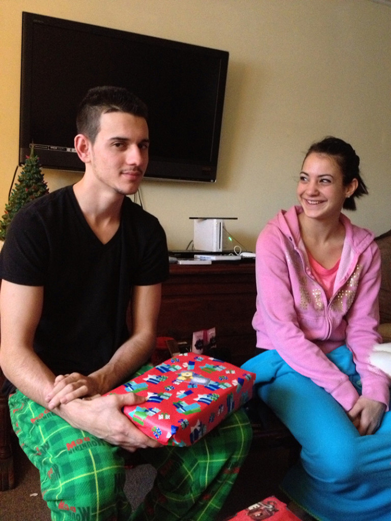 Derrick Thompson and Alivia Welch share a funny moment on Christmas Day on 2012 shortly before they were murdered by Thompson's landlord, James Pak, on Dec. 29, 2012.