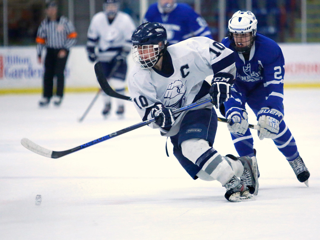 Barber Yarmouth Maine : Patrick Grant of Yarmouth advances the puck ahead of Donovan Connor of ...