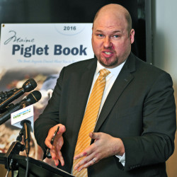 "Matthew Gagnon of the Maine Heritage Policy Center talks about the 2016 Maine Piglet Book during a news conference Thursday at the State House Welcome Center in Augusta. In a news release, the policy center said that the booklet ""highlights the rampant and appalling examples of the abuse of taxpayer dollars that big government doesn't want you to know about."""
