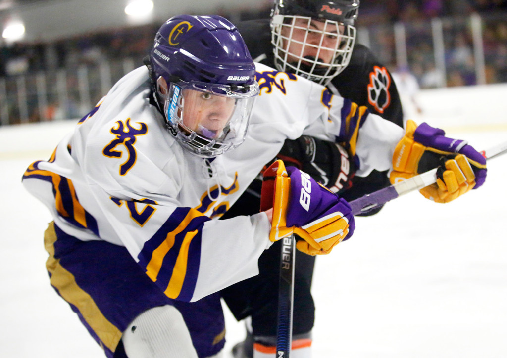 Ryan McSorely of Cheverus fights for the puck with Brady Crepeau of Biddeford during the third period of Monday's Class A South quarterfinal game. Cheverus came from behind to win in overtime, 6-5. Scarborough is the No. 1 seed in the Class A South playoffs, while Cheverus is seeded fourth.
