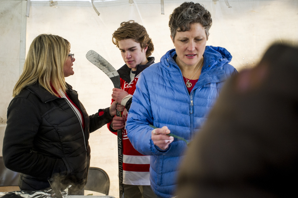 """Allison Stailing talks with son Caleb Rowland, a hockey player at South Portland High whose team will benefit from the chili-chowder challenge in South Portland last weekend. """"Everything she cooks is good,"""" says her friend and sometimes sous chef Heidi Colton."""