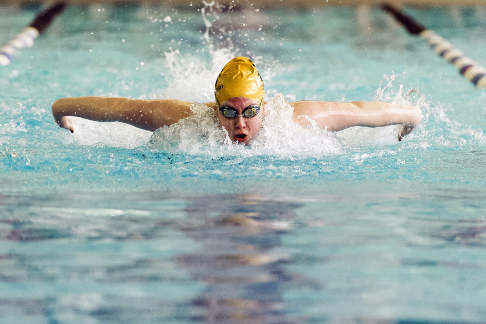 Ana Neff-Jendrasko of McAuley finishes the final lap of the 100-yard freestyle, which she won, at the girls' North Southwesterns swimming championships at Cape Elizabeth High School on Saturday.