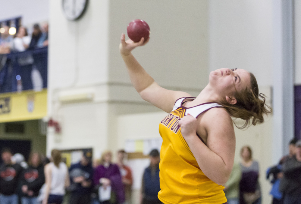 Samantha Curran of Thornton Academy unleashes a throw on her way to victory in the shot put. Curran won the event by more than five feet, with a heave of 38-11 .