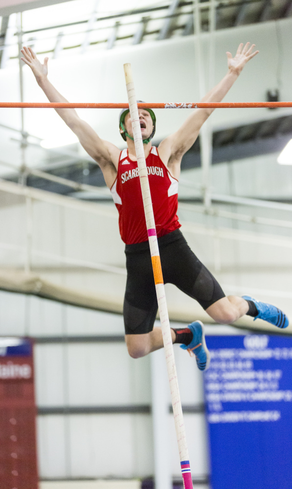Scarborough's Sam Rusak rejoices after clearing the pole vault bar at a league-record height of 15-6. Rusak was also successful at 15-9, and won the high jump as well.