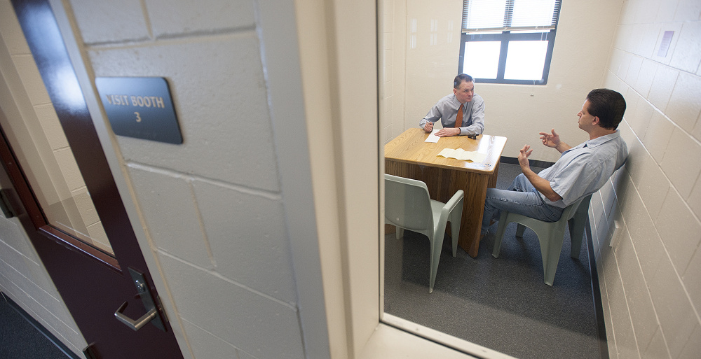 Inmate Jeffrey Libby, right, talks with Sunday Telegram reporter Scott Dolan during a prison interview regarding the Department of Corrections' restrictions on his opinion writing.