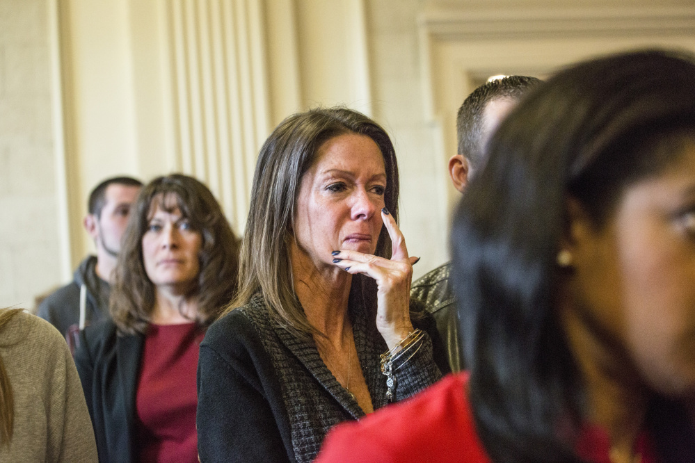 Susan Johnson wipes a tear from her cheek as James Pak receives two life sentences in the 2012 murders of her son, Derrick Thompson, and his girlfriend, Alivia Welch, at Superior Court in Alfred on Thursday. Johnson was wounded in the attack.