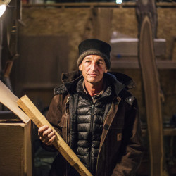 David Moses Bridges, a maker of traditional Passamaquoddy birch bark canoes, is shown working in a South Portland workshop while he underwent cancer therapy at Maine Medical Center in Portland. He died Friday at age 54.