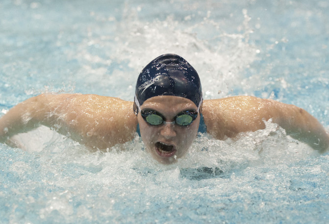 Caitlin Tycz of Brunswick High competes in the 200-yard individual medley during the Class A girls swim championships at the University of Maine in Orono on Saturday. Tycz won two individual events and anchored the Dragons to two relay victories as Brunswick took the team title. Kevin Bennett Photo