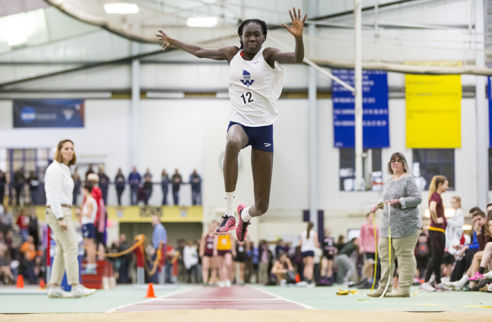 Nyagoa Bayak, a freshman at Westbrook High, competes in the junior division triple jump at the Southern Maine Activities Association indoor track championships. She has improved dramatically in both the triple jump and long jump during the past month.