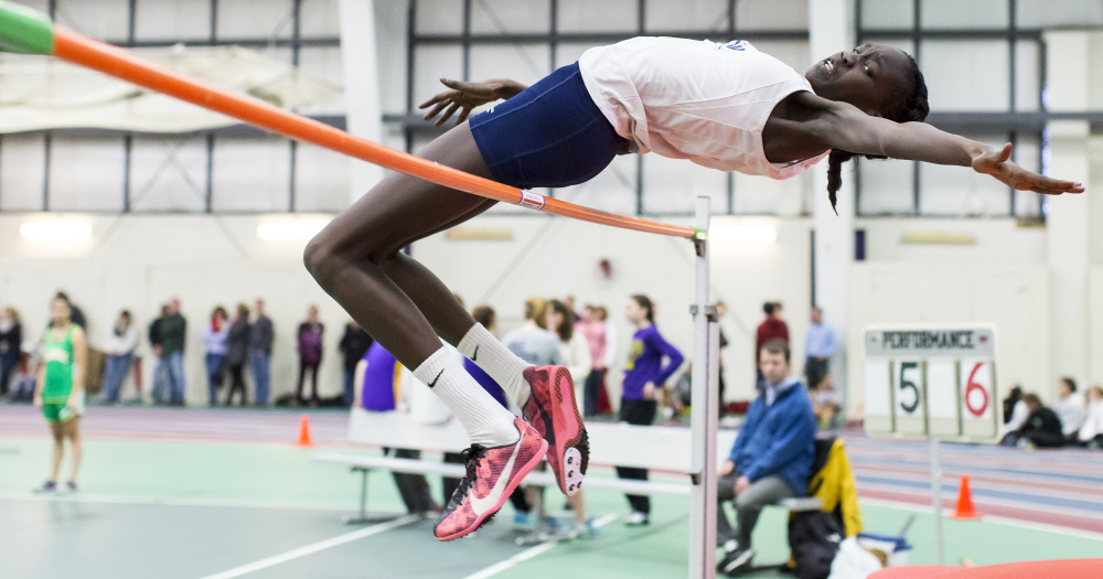 Nyagoa Bayak, a freshman at Westbrook High School, takes flight during the junior division girls high jump at the Southern Maine Activities Association indoor track championships. Bayak placed first in the high jump and long jump.