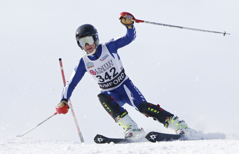 Griffin Primeau, of Yarmouth High School, skis the slalom Wednesday during the Class B Alpine ski championships in Rumford.