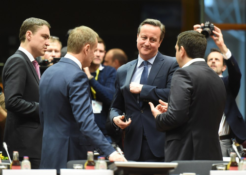 British Prime Minister David Cameron, center, speaks with Greek Prime Minister Alexis Tsipras, right, and European Council President Donald Tusk during an EU meeting Thursday.