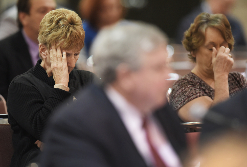 Val Champa, left, the mother of Louis Champa, Jr. who was lost with other crew members when the El Faro sank, listens to phone call recordings from the ship's Capt. Michael Davidson, in Jacksonville, Fla., during a U.S. Coast Guard investigative hearing.