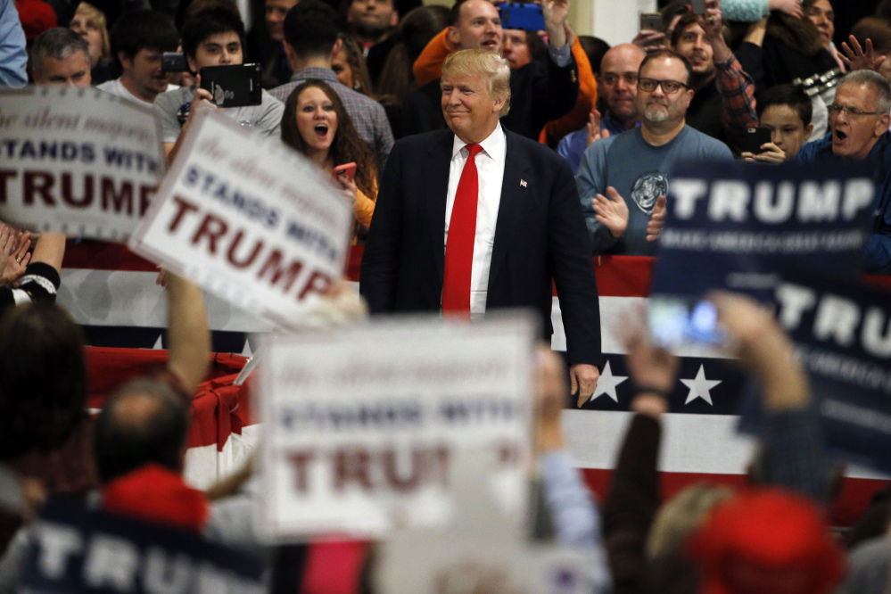 Republican presidential candidate Donald Trump makes his way to the stage during a campaign stop Friday, Feb. 19, 2016, in North Charleston, S.C. (AP Photo/Matt Rourke)