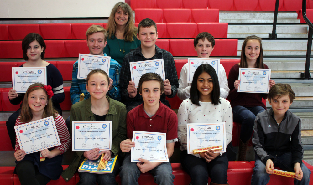 Winners of the recent local level of the National Geographic Society's 28th National Geography Bee at Wells Junior High School are, second row from left: Natalie Hanagan, Tyler Evans, Ethan Beals, Sam Norbert and Kate Pinette. First row, from left:  Annabelle Breton, Katie Plourde, Griffin Allaire, Jaidyn Patel and Auggie Ciorra. Teacher and moderator Bonnie Dill is in back.