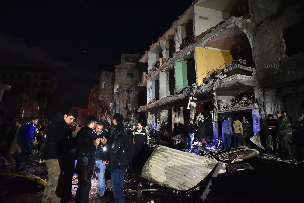 The Islamic State group claimed responsibility for a multiple blasts in the Damascus suburb of Sayyida Zeinab, saying two IS fighters set off a car bomb before detonating their explosive belts and killing dozens. Residents said the attack was about a kilometer (0.6 mile) from one of Shiite Islam's holiest shrines and did not damage it. (AP Photo/Natalia Sancha)