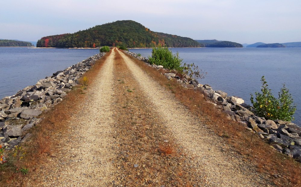 A dirt road leads to Mount Zion Island at the Quabbin Reservoir in Petersham, Massachusetts. Nancy Allen, chairwoman of the town selectboard, says she heard from fearful residents when the rattlesnake plan became public, but those fears have died down.