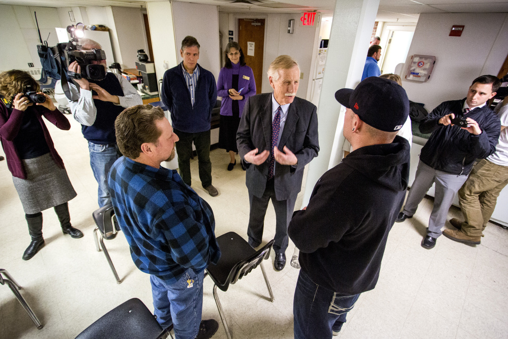 U.S. Sen. Angus King speaks with clients David Lavigne, 49, at left, and Derek Willerson, 36, at right, both clients, as he toured Milestone Foundation Inc. in Portland Monday. Gabe Souza/Staff Photographer