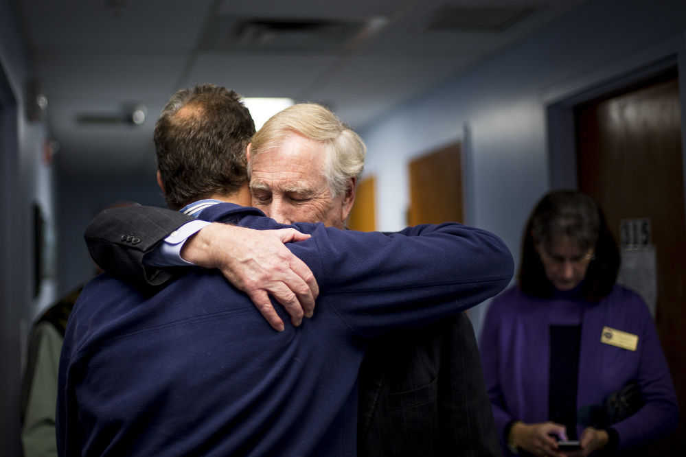 U.S. Sen. Angus King hugs Bob Fowler, executive director of Milestone Foundation Monday after King toured the Foundation's India Street location and talked about new legislation that would confront the heroin and opioid epidemic facing Maine and much of the nation. Gabe Souza/Staff Photographer
