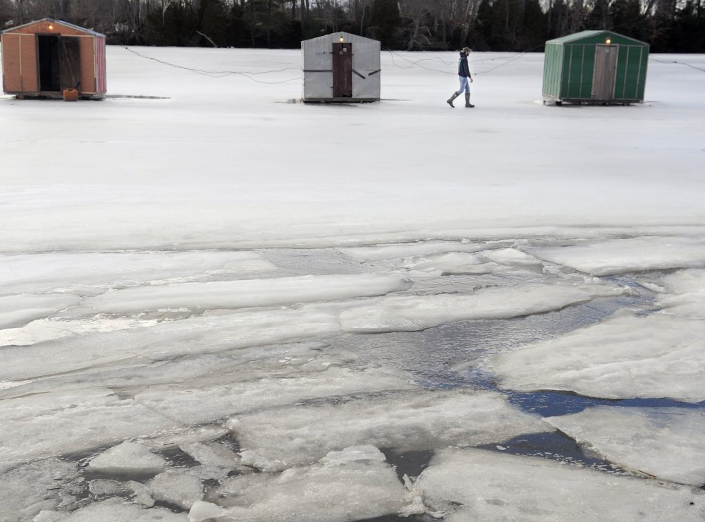 Peter James checks the smelt shacks his family maintains on the Eastern River in Dresden on Sunday. Anglers have been successful fishing on the tides at James Eddy, he said, but mild conditions and weak ice have restricted the season.