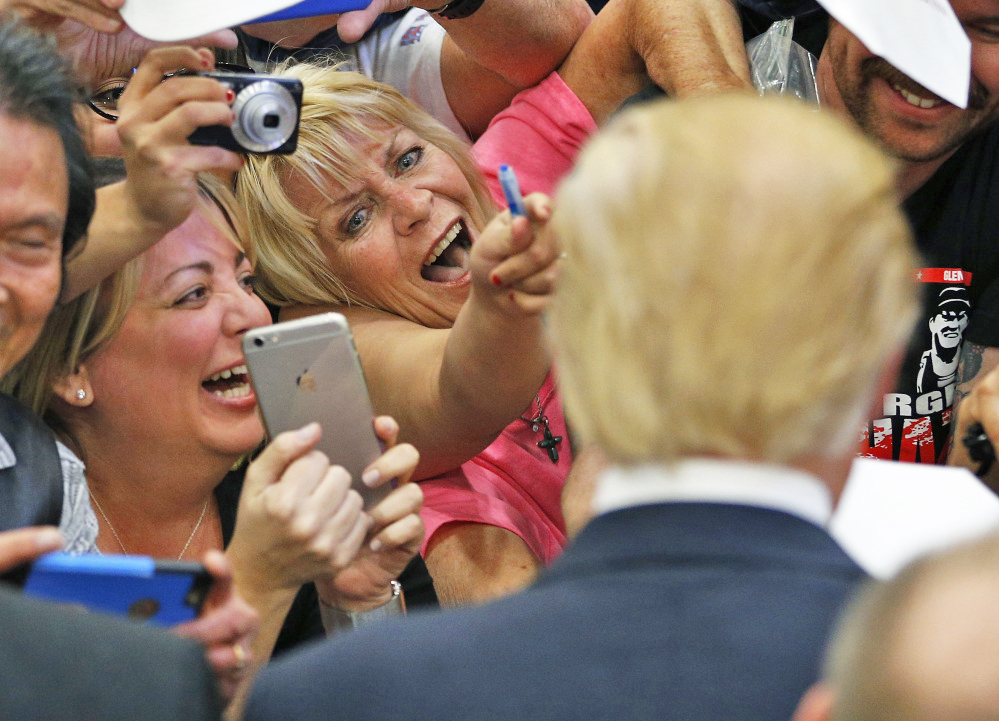 Supporters show their excitement at meeting Republican presidential candidate Donald Trump at a campaign rally Monday in Las Vegas.