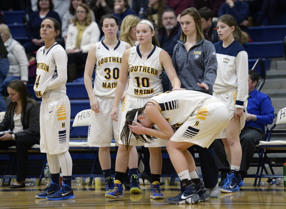 University of Southern Maine's Megan Pelletier, right, is consoled by teammates as the time expires and USM was defeated by UMass-Dartmouth on Tuesday in Gorham.   Shawn Patrick Ouellette/Staff Photographer