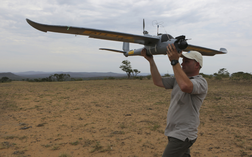 A drone is prepared for launching in the Hluhluwe-iMfolozi Game Reserve in South Africa. Once in flight, conservationists can scan live video from a camera attached to the drone, which can help locate poachers stalking rhinos and other threatened species.