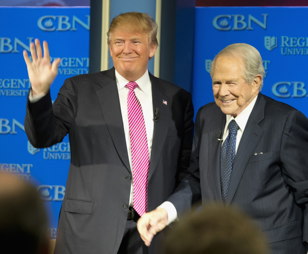 Donald Trump may be on shaky terms with Pope Francis, but Wednesday found him on good graces with Christian conservative Pat Robertson at Regent University in Virginia.