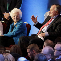 Former President George H.W. Bush, right, and his wife, Barbara Bush, shown at an event in Houston in February 2016, have both been hospitalized in Houston.