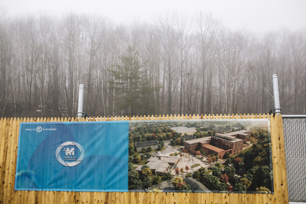 A banner announces the $50 million medical tourism project that's planned for the former shoe factory at 81 Minot Ave. in Auburn. This site and an adjacent former police station have been sold to the Shengton Group of China. The investment group has nearly 200,000 square feet of building space.