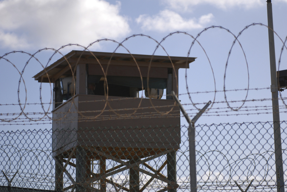 A soldier stands guard in a tower overlooking Camp Delta at Guantanamo Bay Naval Base in a 2009 photo provided by the Navy. The problem with the prison is not as much its physical presence as its symbolic importance.