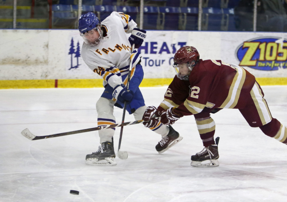 Chase Wescott of Thornton Academy attempts to block a pass by Falmouth's Alex Grade in the third period of Class A South semifinal Saturday at Lewiston.