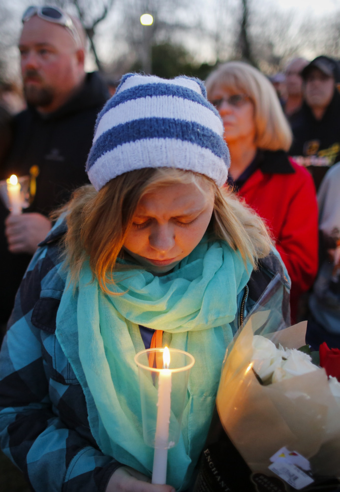 A candlelight vigil at Heritage Park in Hesston, Kan.,  on Friday helps bring a stricken community together after Thursday's massacre.