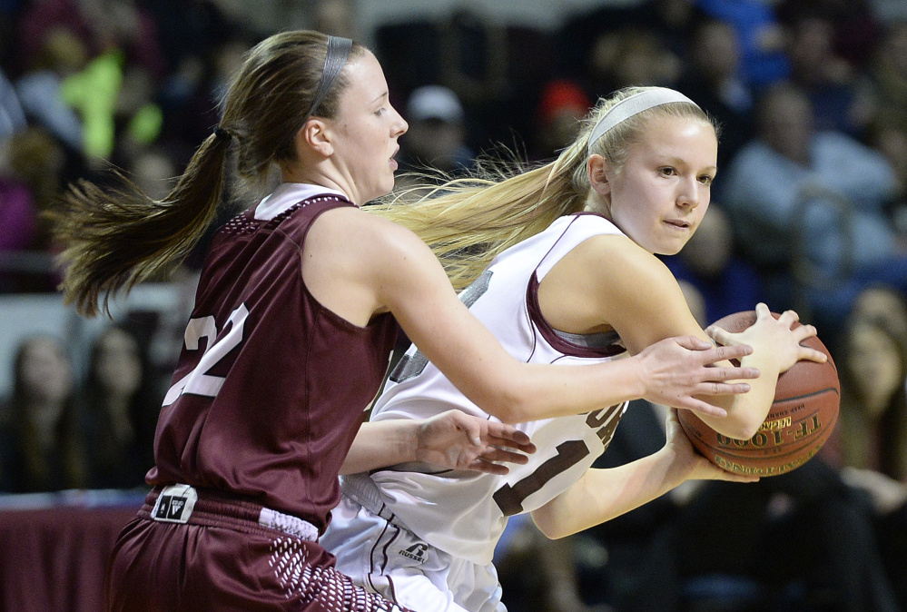 Gorham's Emily Bragg looks for an open teammate while being defended by Edward Little's Piper Norcross during the Rams' 46-36 win in the Class AA state championship game Saturday.